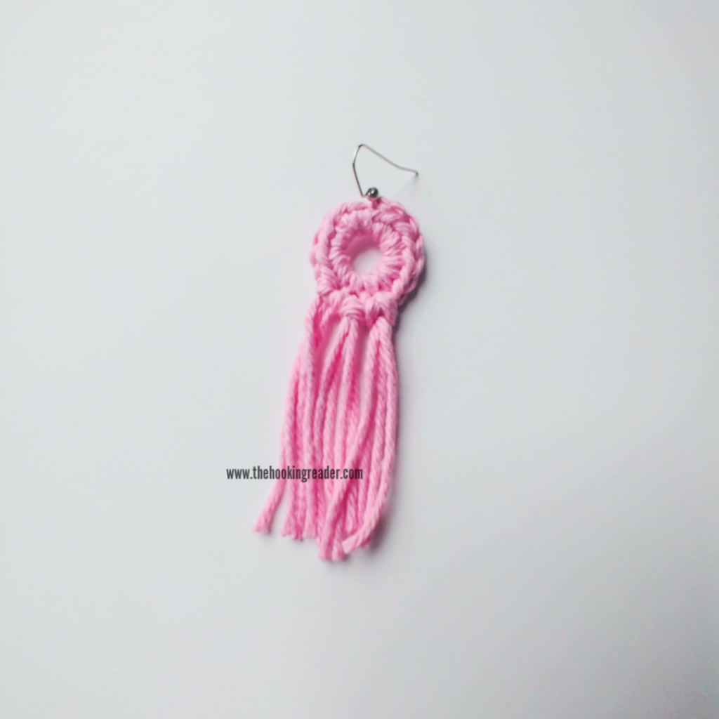 one completed crochet earring