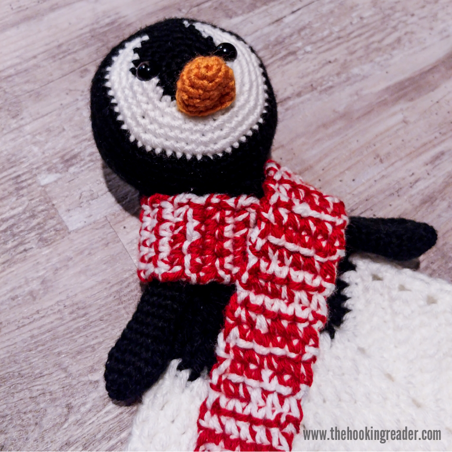 penguin lovey with candy cane scarf
