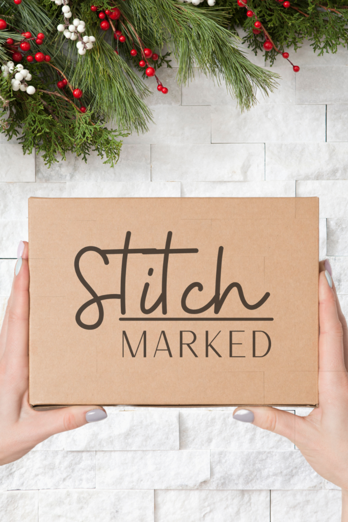 """christmas garland with brown box that says """"StitchMarked"""""""