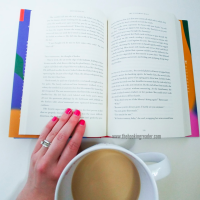 open book with coffee mug
